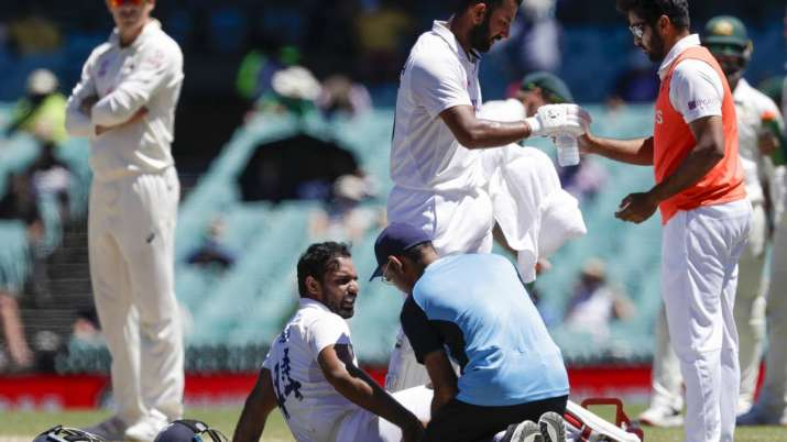 India's Hanuma Vihari receives treatment to a leg injury