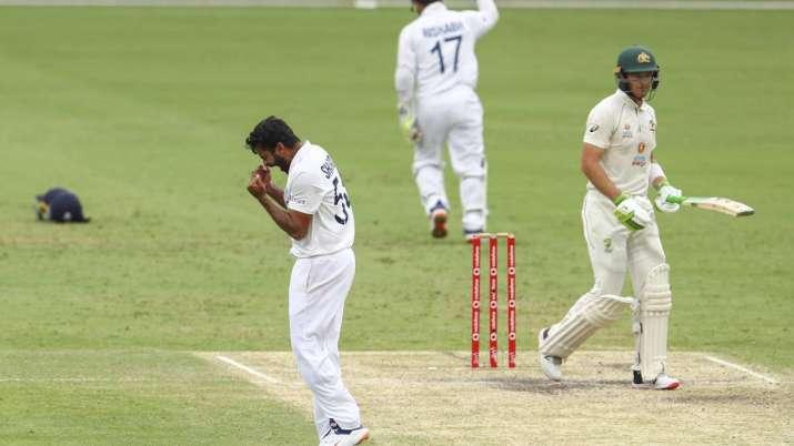 India's Shardul Thakur, left, celebrates the dismissal of