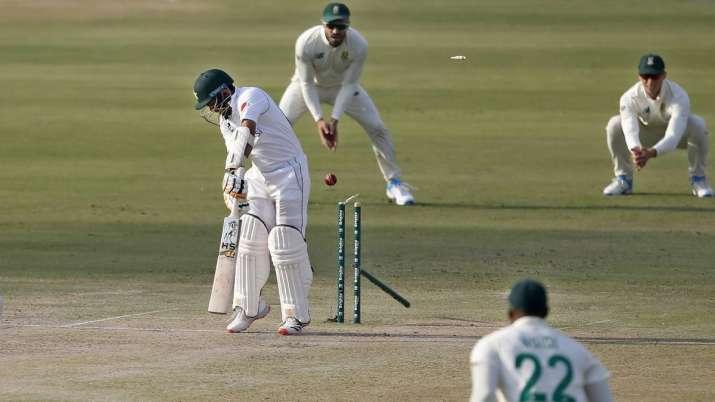 Pakistan's batsman Abid Ali, center, is bowled out by South
