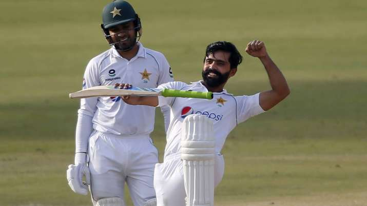 Pakistan's Fawad Alam, right, celebrates after scoring