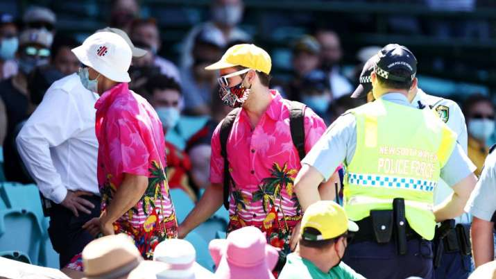 Police speak to spectators following a complaint from