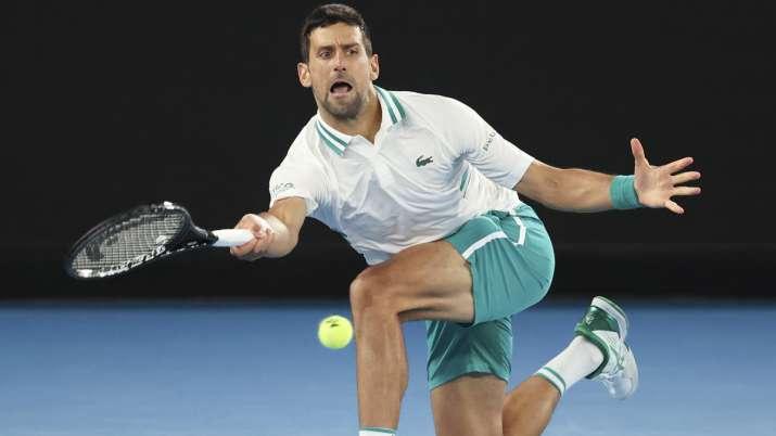 Serbia's Novak Djokovic hits a forehand return to Canada's