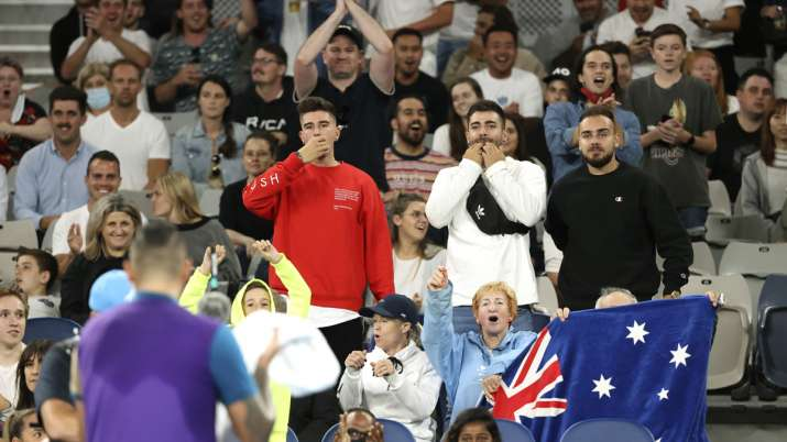 Fans cheer for Australia's Nick Kyrgios, back to camera,