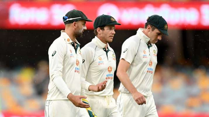 Tim Paine, Nathan Lyon and Pat Cummins of Australia are