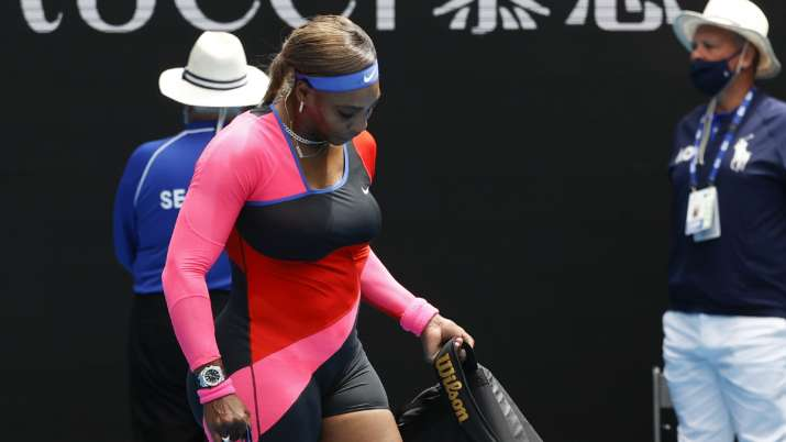 United States' Serena Williams carries her bags as she