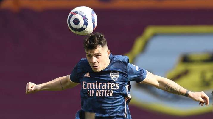 Arsenal's Granit Xhaka heads the ball during the English
