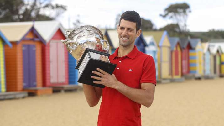 Serbia's Novak Djokovic poses for photos with the Norman
