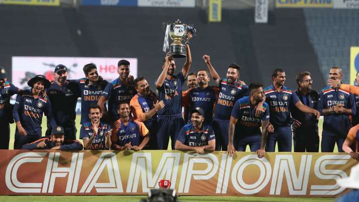Players and Staff of India pose with the trophy after