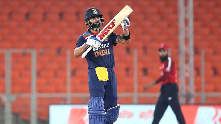 India Captain Virat Kohli celebrates after making 50 during