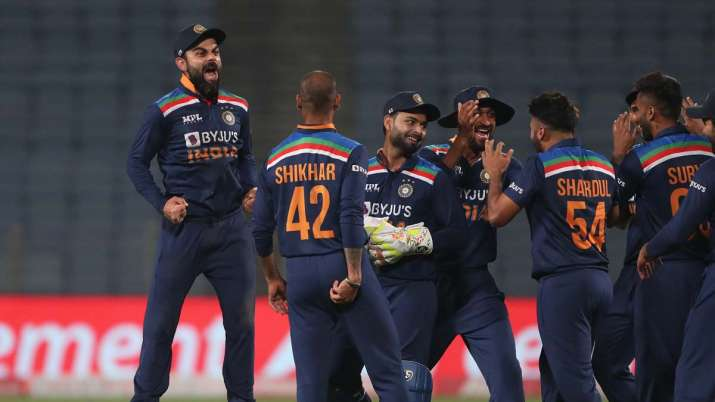 Virat Kohli of India (L) celebrates the wicket of Jos