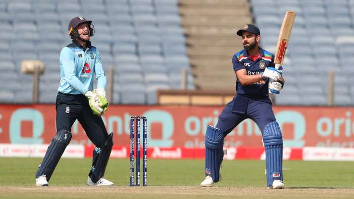 England wicketkeeper Jos Buttler celebrates after catching