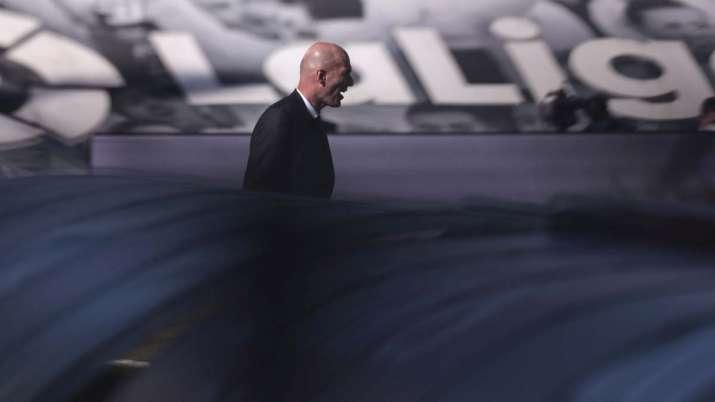 Real Madrid's head coach Zinedine Zidane reacts at the