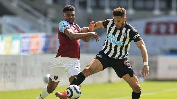 Newcastle's Joelinton, right, battles for the ball with