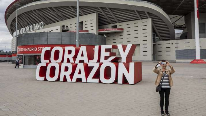 A woman takes a snapshot in front Atletico Madrid's Wanda
