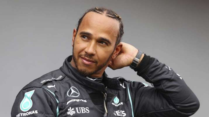 Mercedes driver Lewis Hamilton of Britain smiles after