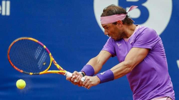 Rafael Nadal of Spain returns the ball to Ilya Ivashka of