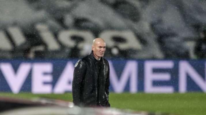 Real Madrid's head coach Zinedine Zidane looks on during