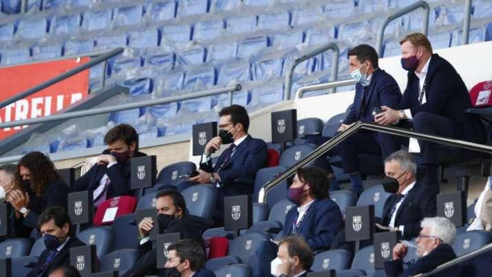 Barcelona's head coach Ronald Koeman, top right, watches