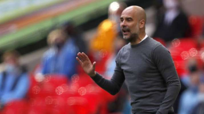 Manchester City's head coach Pep Guardiola gestures during