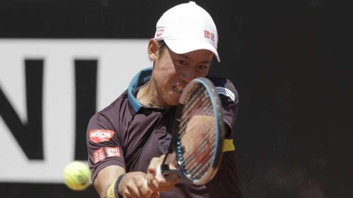 Japan's Kei Nishikori returns the ball to Italy's Fabio