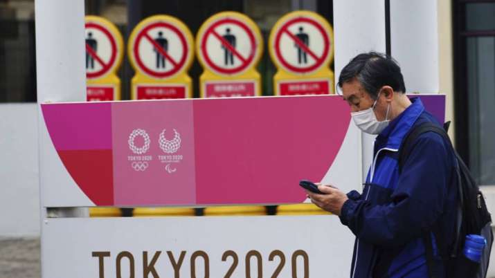 A man wearing a protective mask to help curb the spread of