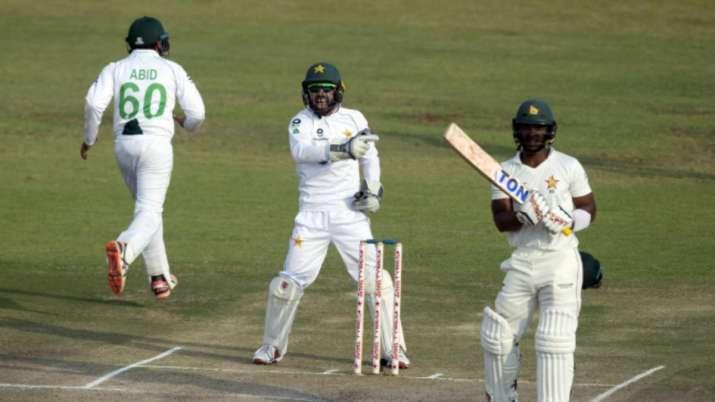 Pakistan wicketkeeper Mohammad Rizwan, centre, celebrates