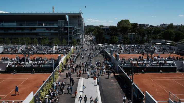 Visitors stroll in the alleys of the Roland Garros stadium
