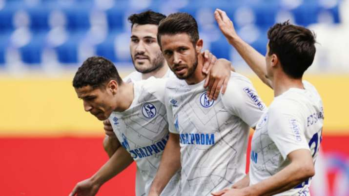 Schalke's scorer Mark Uth, second right, and his teammates