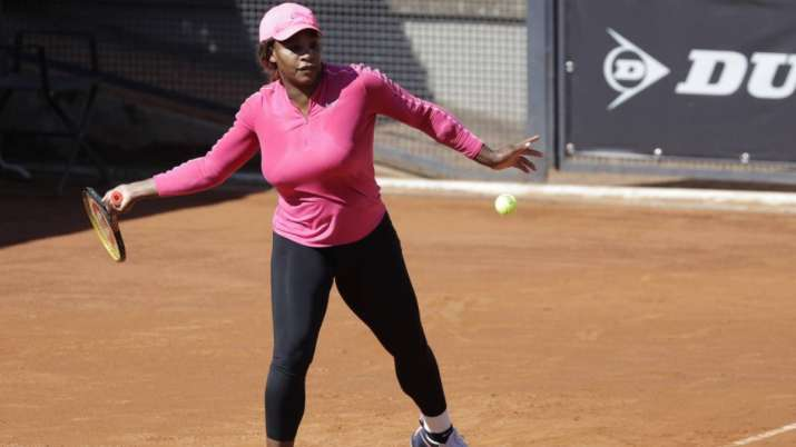 Serena Williams returns the ball during a training session