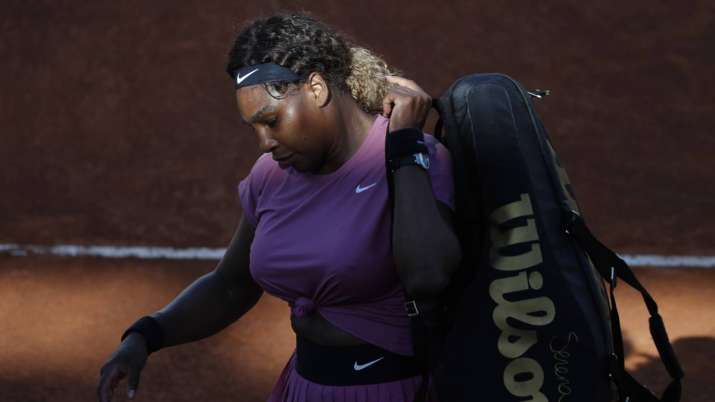 Serena Williams, of the United States, leaves the court at