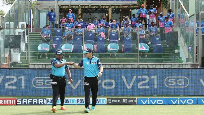 The umpires take to the field during match 28 of the Vivo