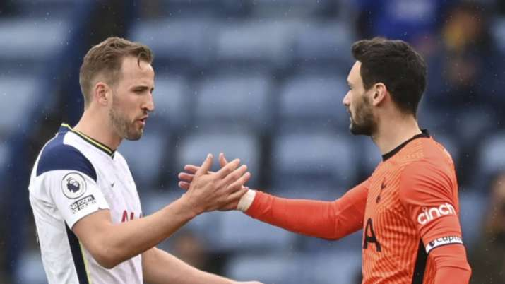 Tottenham's Harry Kane, left, shakes hands with Tottenham's