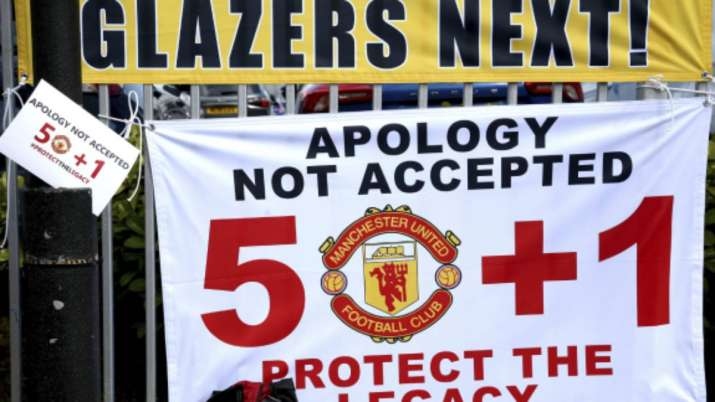 Banners near the stadium as fans protest against the Glazer