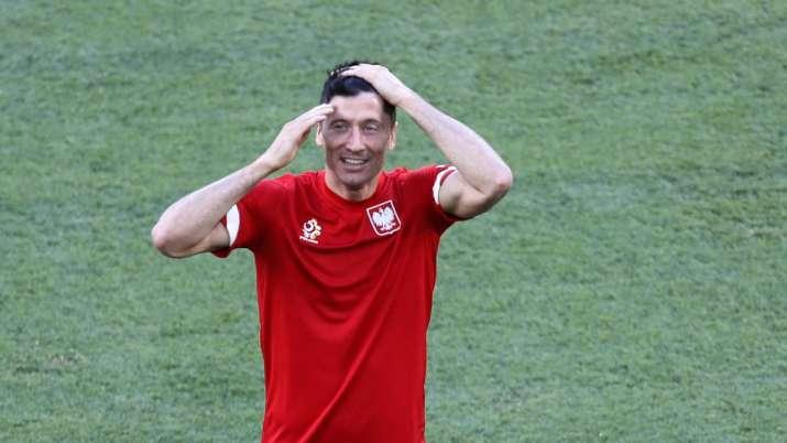 Poland's Robert Lewandowski smiles during training session