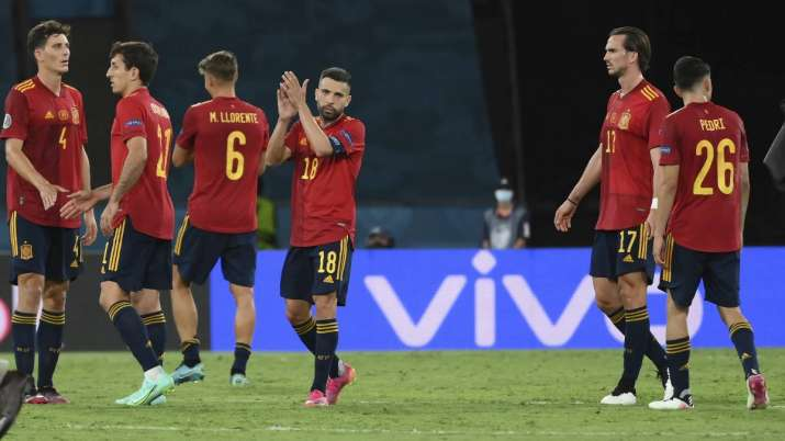 Spanish players react after the Euro 2020 soccer