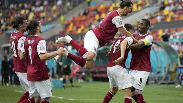 Austria's Christoph Baumgartner (9) celebrates after