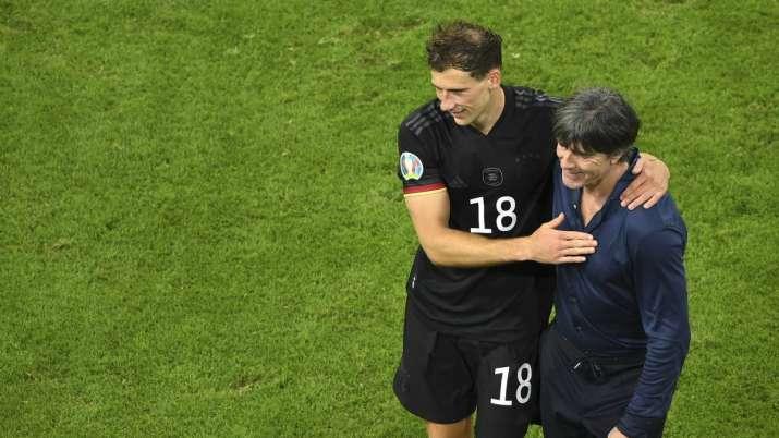 Germany's manager Joachim Loew greets Germany's Leon