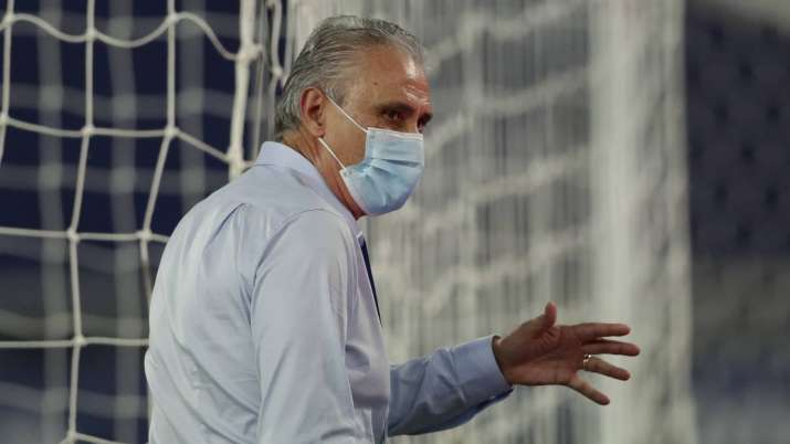Brazil's coach Tite stands in the pitch prior to a Copa
