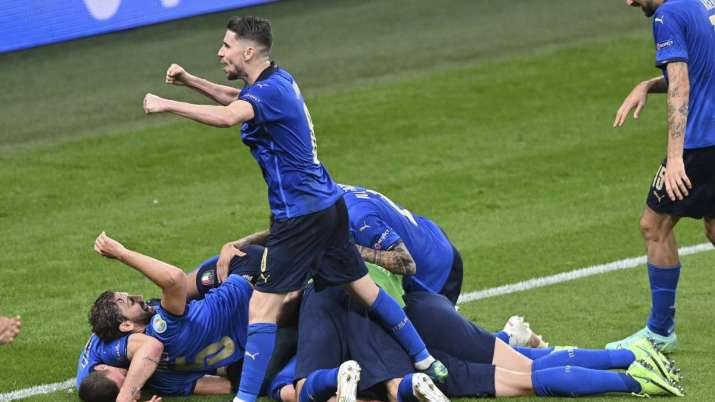 Italy's players celebrate after scoring their side's second