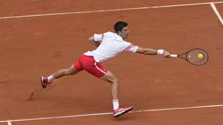 Serbia's Novak Djokovic plays a return to Italy's Lorenzo