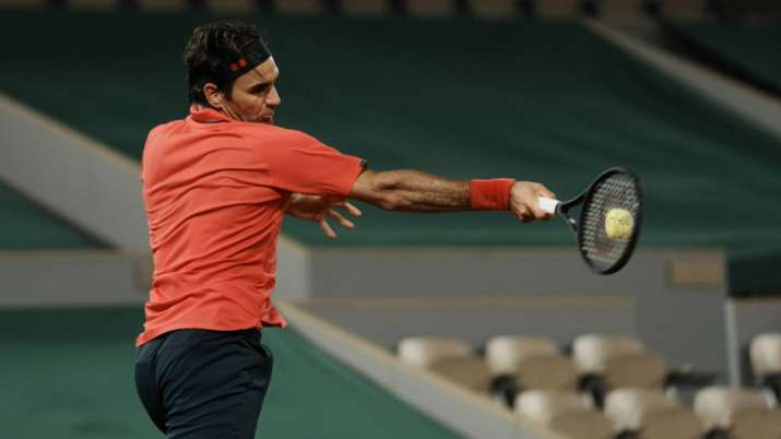 Switzerland's Roger Federer plays a return to Germany's
