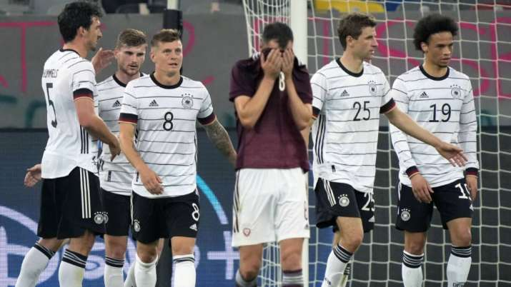 Latvia's Eduards Emsis, front, reacts during the