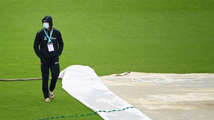 Devon Conway of New Zealand walks across the outfield as
