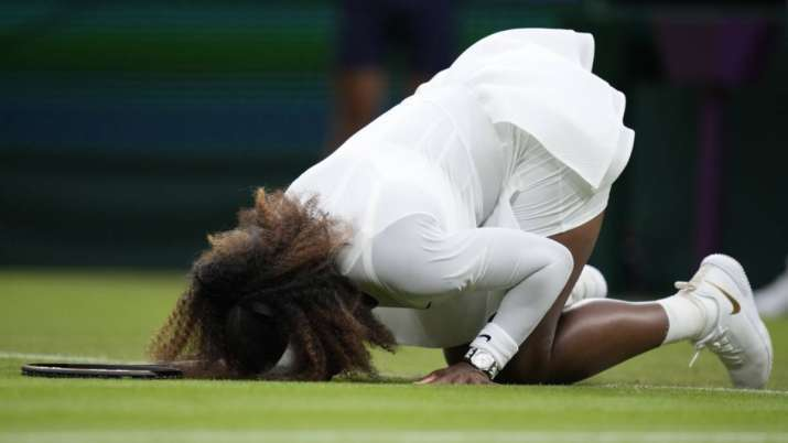 Serena Williams of the US falls to the ground during the