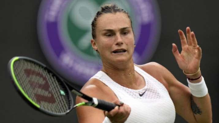 Belarus's Aryna Sabalenka returns the ball to Romania's