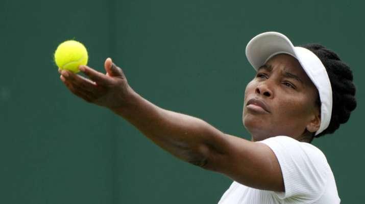 Venus Williams of the US serves to Romania's Mihaela