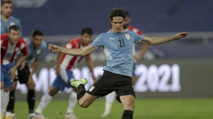 Uruguay's Edinson Cavani scores from the penalty spot