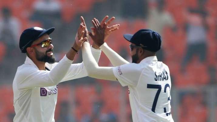 Virat Kohli, Mohammed Siraj,
