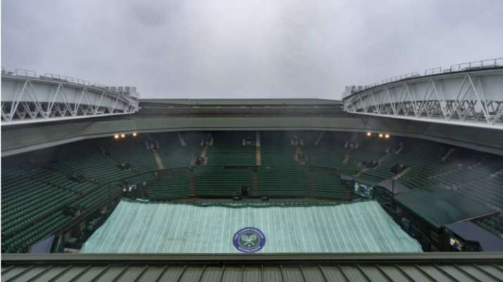 Covers remain in place on the Centre Court as rain