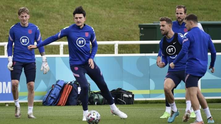 England's goalkeeper Jordan Pickford, Harry Maguire, Jordan